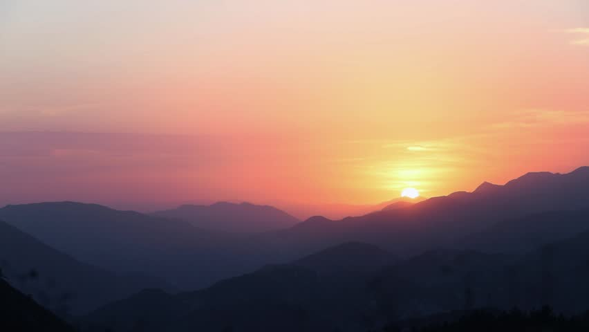 Time lapse the sun setting during the summer in Angeles Crest forest. The mountains are in the foreground as the sun goes down on the right hand side. orange and vibrant colors   Shutterstock HD Video #1013496047