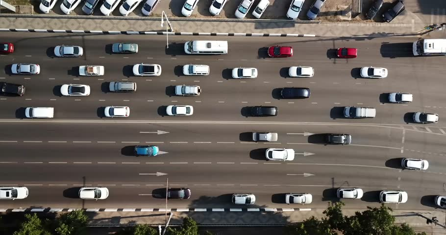 Aerial Drone Flight top down View of freeway busy city rush hour heavy traffic jam highway.  Aerial view of the vehicular intersection,  traffic at peak hour with cars on the road, over the bridge.   Shutterstock HD Video #1013548277