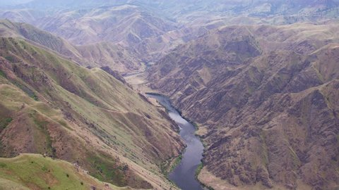 Panning Aerial view looking down on the Snake River in the Hells Canyon section in Idaho