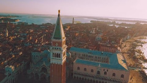 aerial orbit over san marco square at sunrise in venice italy