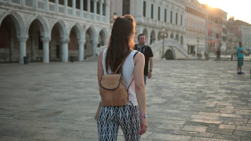 Venice, Italy - 05 26 2018: Girlwalking at Marcus square at pier.