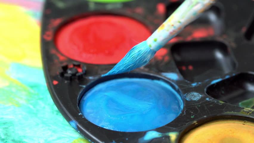 Brush taking blue watercolor on color palette  | Shutterstock HD Video #1013598437