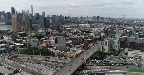 Aerial of Long Island City and surrounding area shot in June of 2018. Long Island City is a redeveloped industrial area along the East River in Queens.
