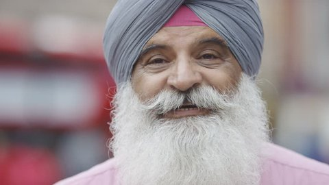 Older Indian male talking to camera