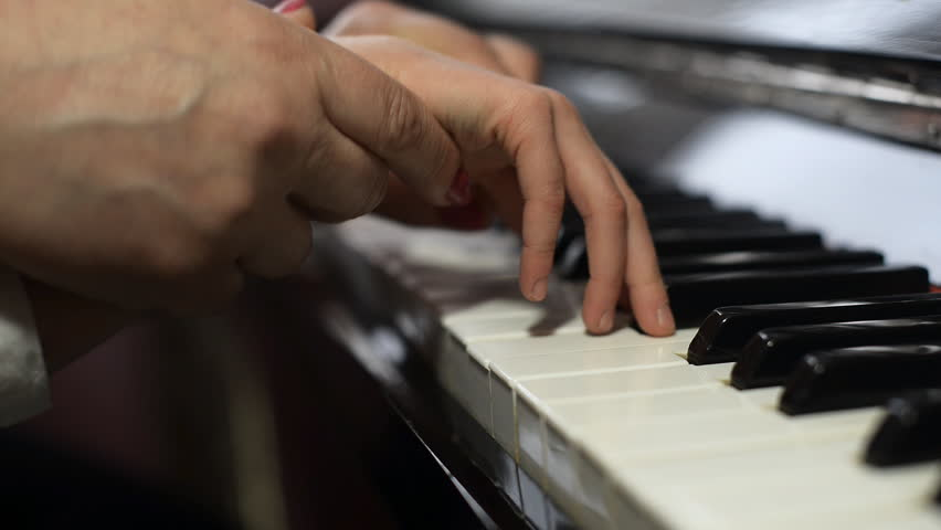 Woman teaches the child to play the piano. | Shutterstock HD Video #10136627