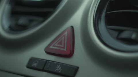 the panic alarm button is blinking inside a car