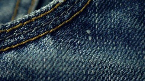 Blue denim jeans close up 4K stock footage. Blue denim Jeans in close up with a sliding camera move.