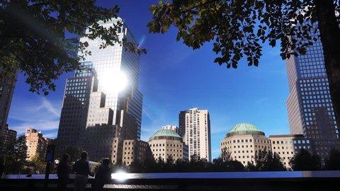 Some tourists are walking around The Ground Zero memorial in Manatthan, New York, USA.