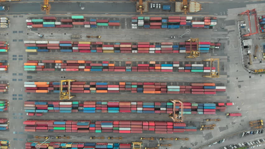 Aerial view over industrial import or export port of Thailand in Bangkok with many rows and stacks of container and big container loader ship vessel. | Shutterstock HD Video #1013719157
