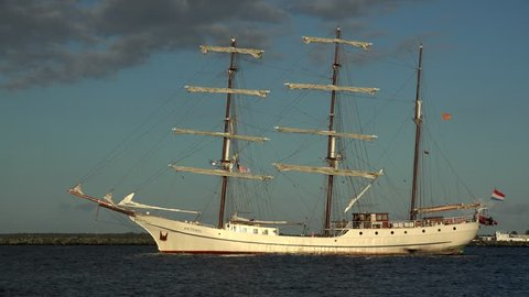 Sailing ship leaving the harbour of Warnemuende, Rostock, Mecklenburg-Western Pomerania, Germany