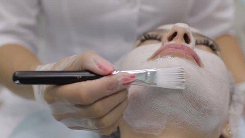 acne blackhead remover. Female face, beauty clinic.