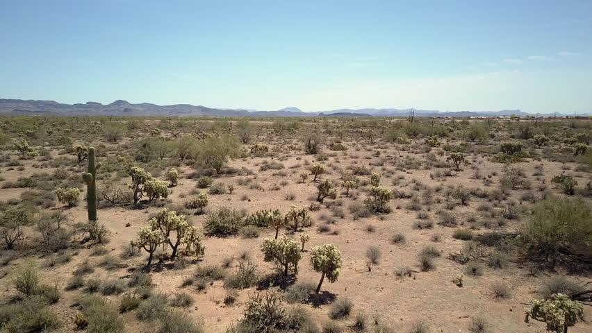 Aerial Drone shot of low flying through desert