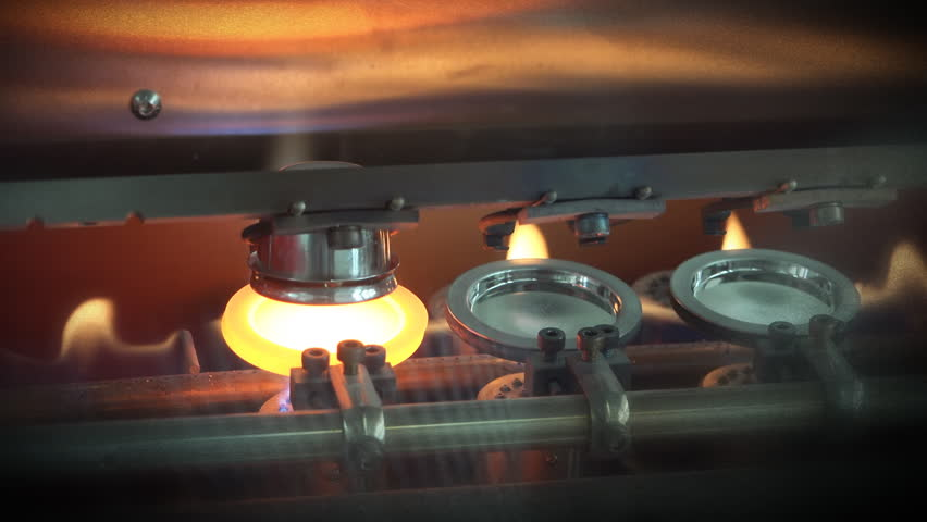 Incandescent liquid hot metal poured from crucible into the mold