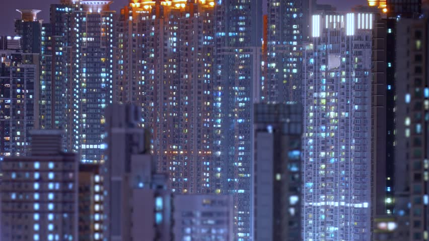 Loop of Hong Kong apartments at night. Chinese crowded city with lights turning on and off at midnight. Fast paced modern Asian night-scape time lapse in urban metropolis. | Shutterstock HD Video #1013780267