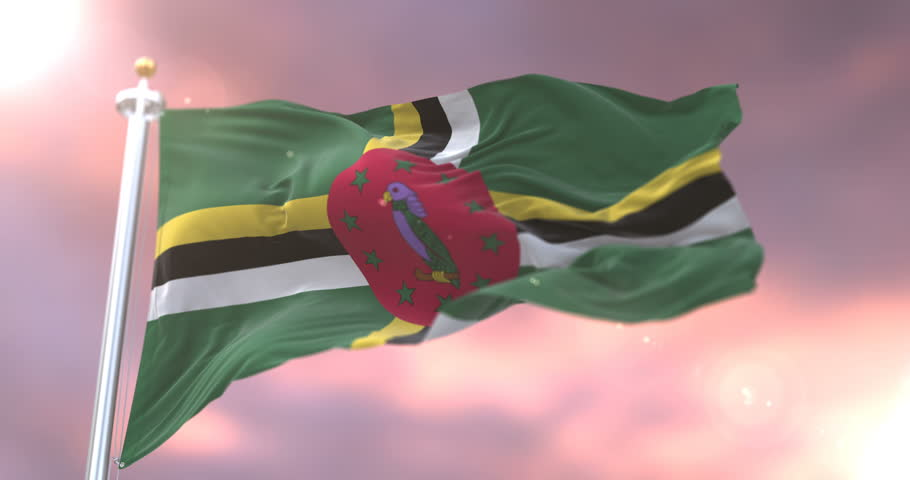 Flag of Dominica waving at wind at sunset in slow, loop