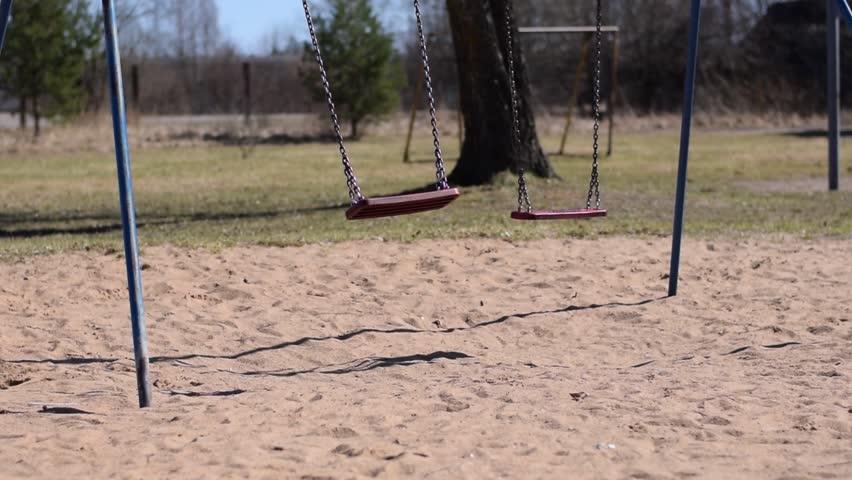 Empty swing swinging. Apocalyptic feel. Moody