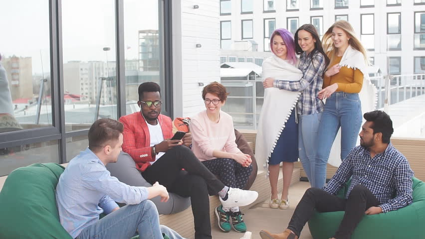 Business meeting of young talanted top photographers. Top view of buiness team brainstorming while sitting at office lounge zone   Shutterstock HD Video #1013800037