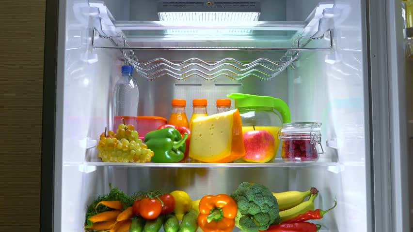 Open refrigerator filled with food. Healthy food.   Shutterstock HD Video #1013810747
