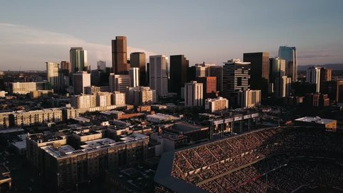 4k aerial drone footage - Skyline of the city of Denver Colorado at sunset.