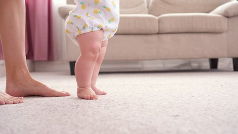 Baby girl walking her first steps
