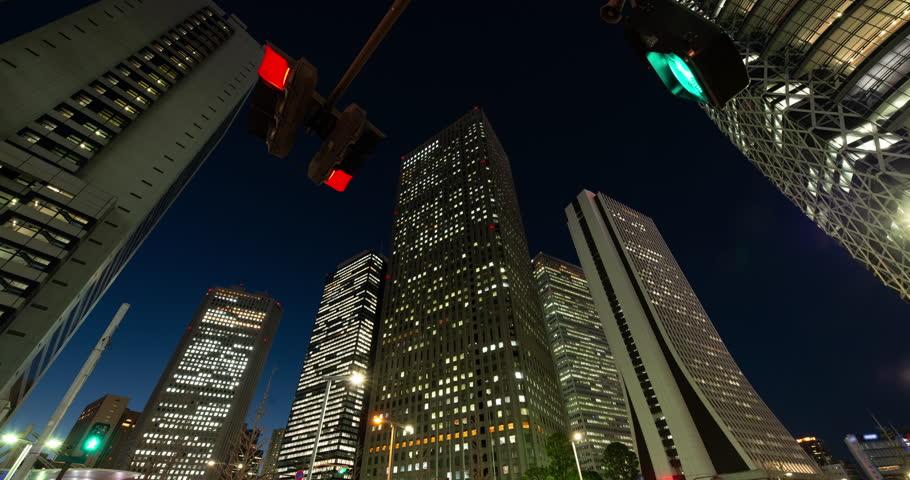 Urban Skyline in Shinjuku Tokyo at Night (tilt down)