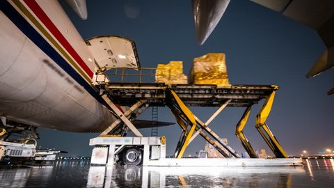 Time lapse loading cargo plane outside air freight logistic with rain storm