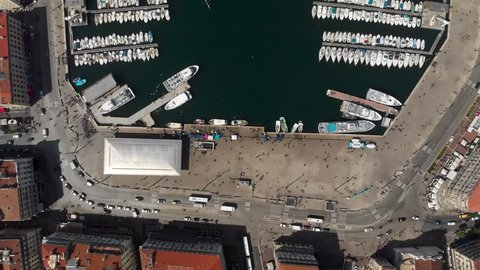 Marseille-2018: Aerial shot flying over Le Vieux Port de Marseille. The old port of Marseille in southern France, a marina for pleasure boats and tourist ships. Many yachts moored in French docks.