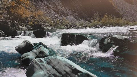 Raging Mountain river. Wildness of clean, clear water in the mountain river. Slow Motion. concept of treatment of urological diseases.