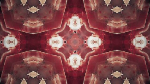 Red kaleidoscope sequence patterns. Abstract multicolored motion graphics background. Beautiful bright ornament. Seamless loop