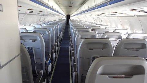 Empty flight, Turkey-Ukraine - 24th of May 2018: 4K Back view on empty passenger saloon on the flight