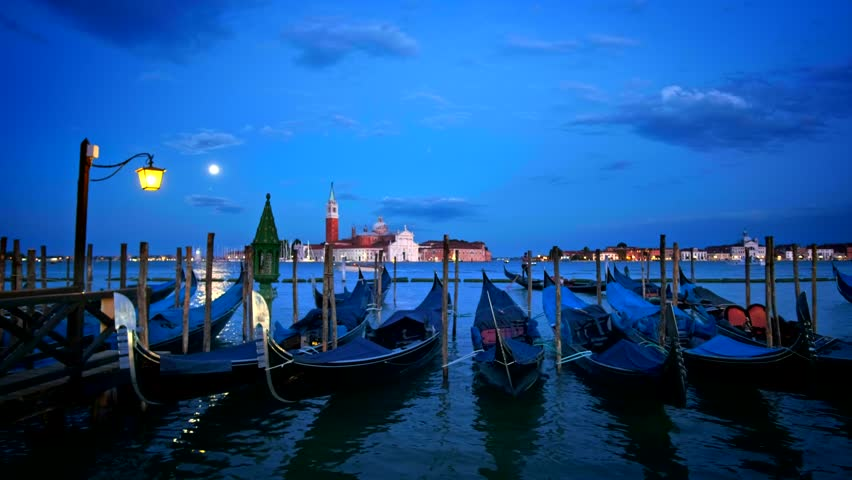 Romantic vacation Venice travel background - gondolas in lagoon of Venice by Saint Mark (San Marco) square with San Giorgio di Maggiore church in background in the evening in Venice, Italy | Shutterstock HD Video #1014003797