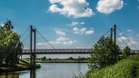 Bridge over the 'Hambeek' in the city of Roermond, in the province of Limburg, The Netherlands. River Meuse in the background.