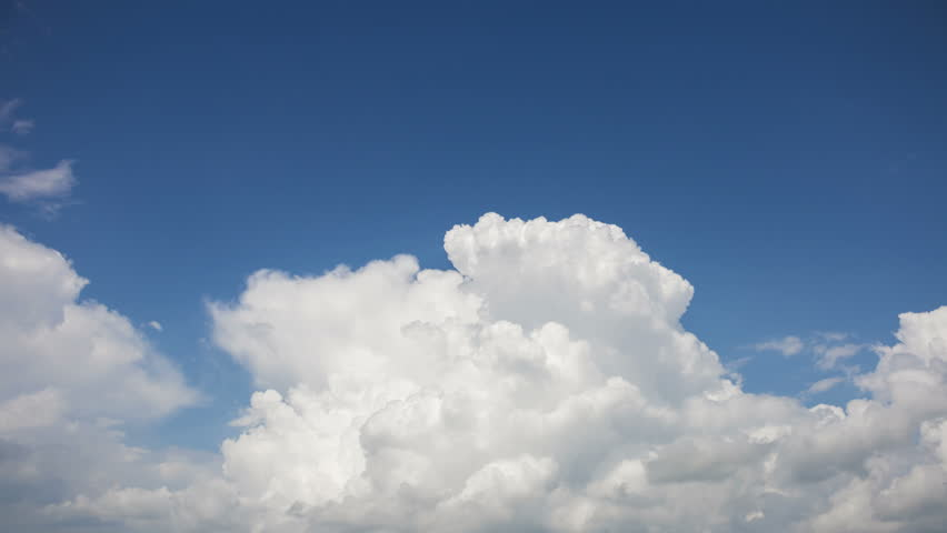 Cumulonimbus cloud on blue sky background, time-lapse.