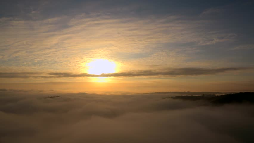Fog patches over landscape and morning sun, Mettlach, Saarland, Germany, Europe | Shutterstock HD Video #1014105767