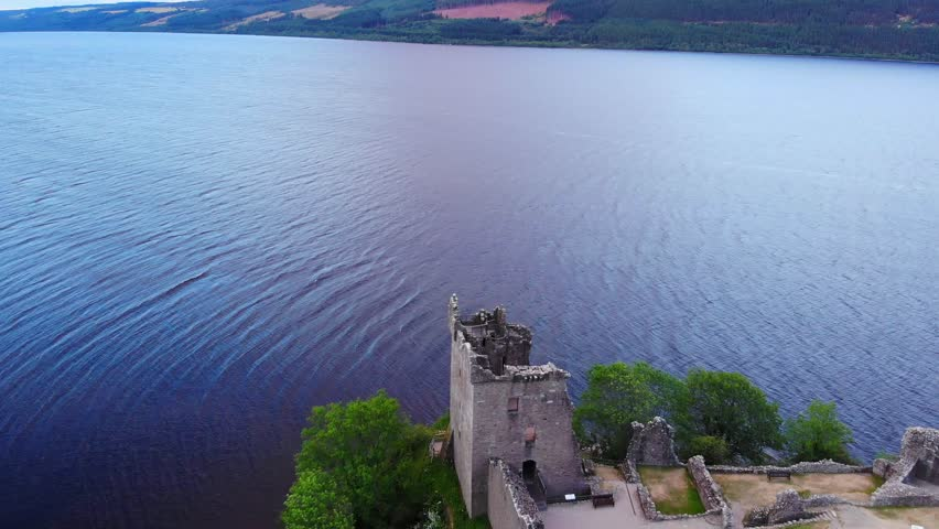 Loch Ness and Urquhart Castle in the evening - aerial drone footage