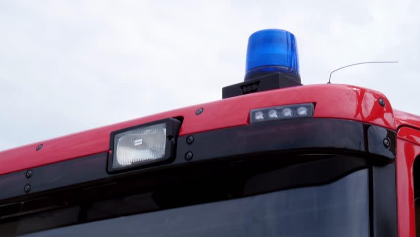 flashing siren of a fire engine