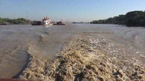 Yangon/Myanmar - December 29, 2015: boats in the river between dala village and Yangon, Myanmar.