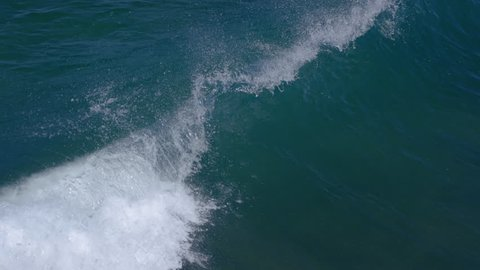 Aerial View Of Wave Crashing In Ocean, Shot On A Long Lens In Slow Motion