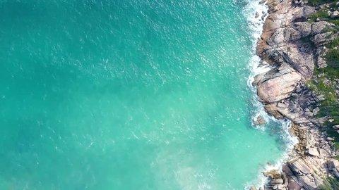 inspiring aerial view azure ocean rippling waves swash against rocky shore in Vietnamese tropics