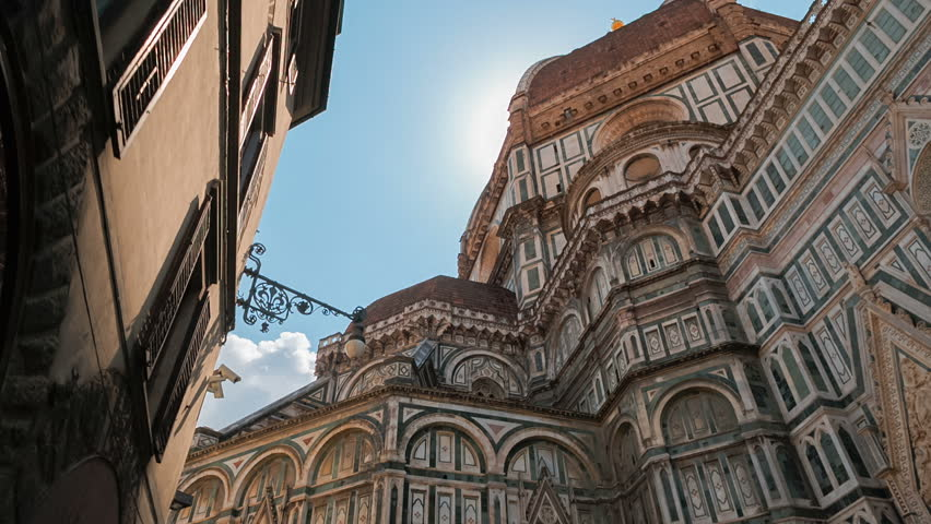 POV shot of the famous Florence Cathedral, also known as Cattedrale di Santa Maria del Fiore or Duomo di Firenze, Tuscany, Italy. Florence is considered the birthplace of the Renaissance | Shutterstock HD Video #1014242417