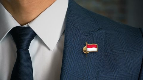 Businessman Walking Towards Camera With Country Flag Pin - Monaco