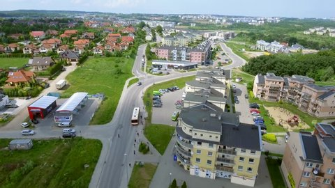 4K. Aerial shot flight over the European city Gdynia-Poland. View from above on the roofs of houses, beautiful gardens, lawns, roads in the summer. Quiet European suburbs.