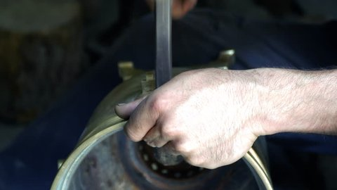 The blacksmith manually forging the molten metal on the anvil in smithy with spark fireworks. Making horseshoes. 4K