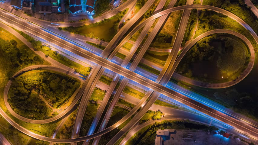 4K Time lapse : Aerial view network or intersection of highway road for transportation or distribution concept background. #1014311237