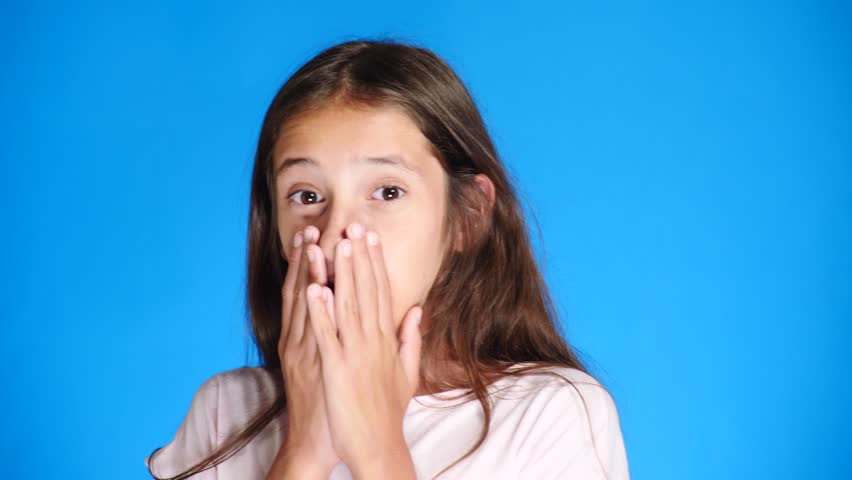Portrait. close-up. Teenage girl on background color. close-up, emotion of fright. 4k, slow motion. | Shutterstock HD Video #1014311387