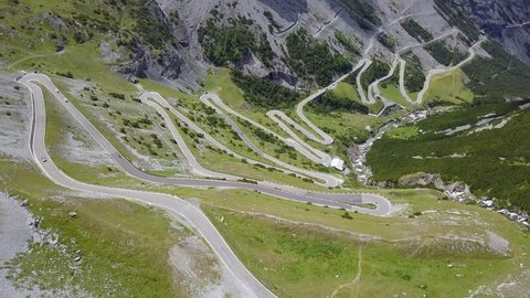 Road to the Stelvio mountain pass in Italy. Amazing aerial view of the mountain bends creating beautiful shapes