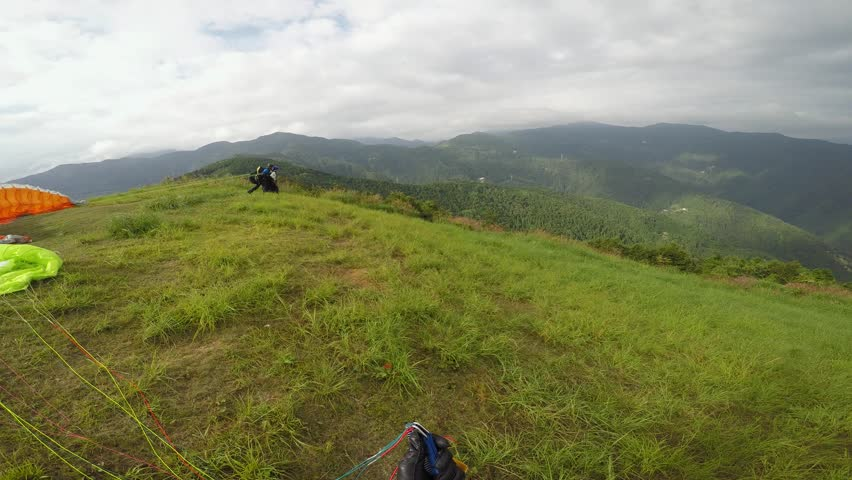 Solo Paraglider launches from mountain and chases a tandem glider in Japan in Summer