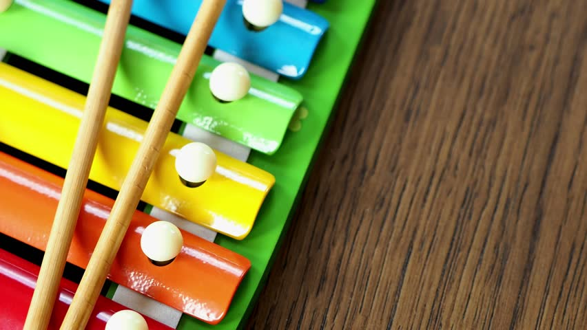 Musical instrument xylophone. Rainbow colored toy xylophone.