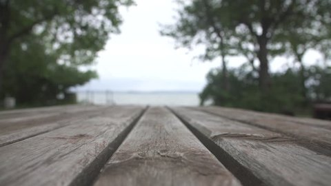 Empty wood table top on blur  background