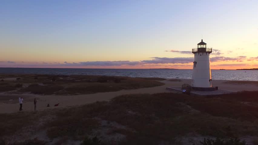 Aerial shot of a beautiful sunrise over the lighthouse in Edgartown, Martha's Vineyard, Massachusetts | Shutterstock HD Video #1014399317